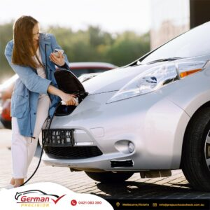 A woman and an electric car - GERMAN PRECISION